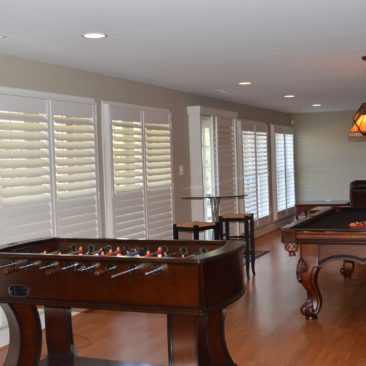 White Wooded Plantation Shutters Pool Room