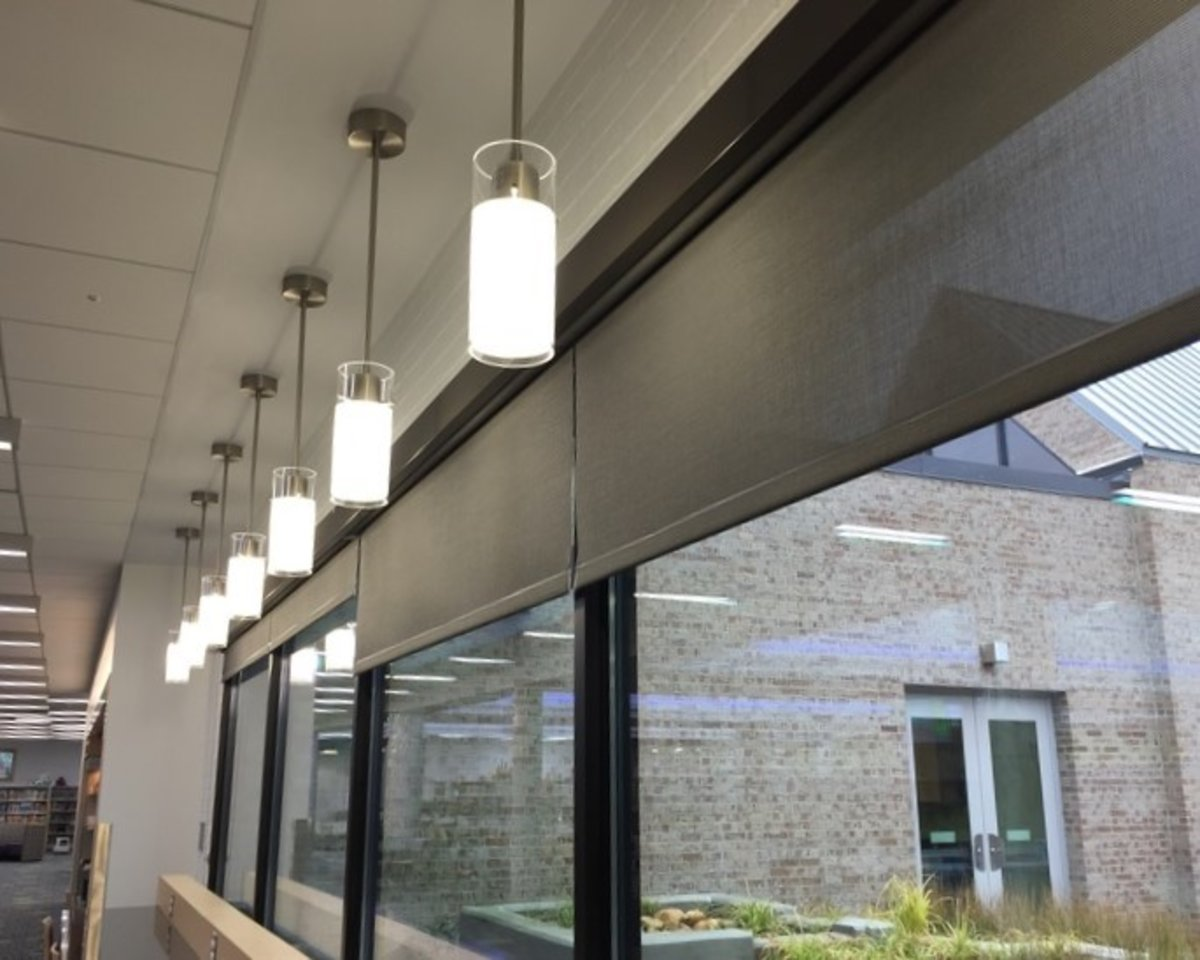 Solar shades for office mcfeely window fashions for Motorized solar shades for windows